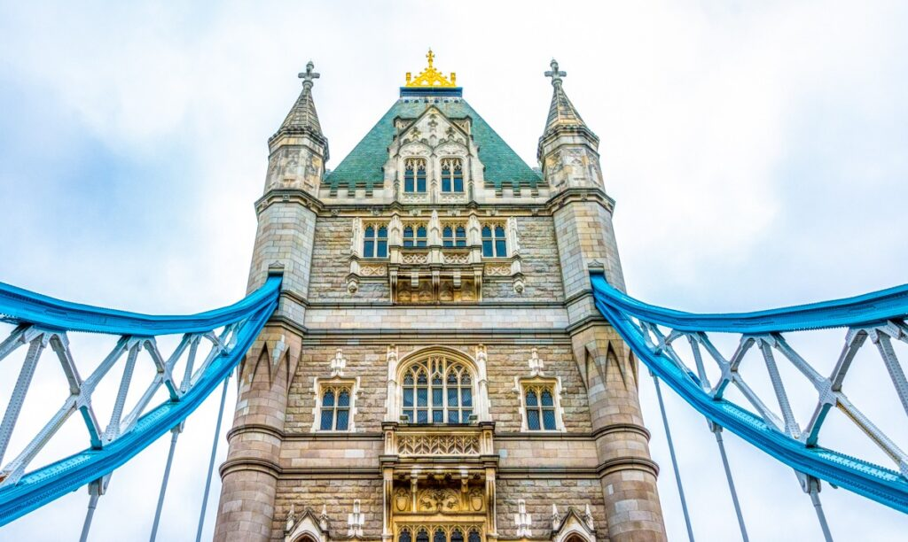 This is an upper view of the south face of the south tower of Tower Bridge, which crosses the Thames River in London, England.