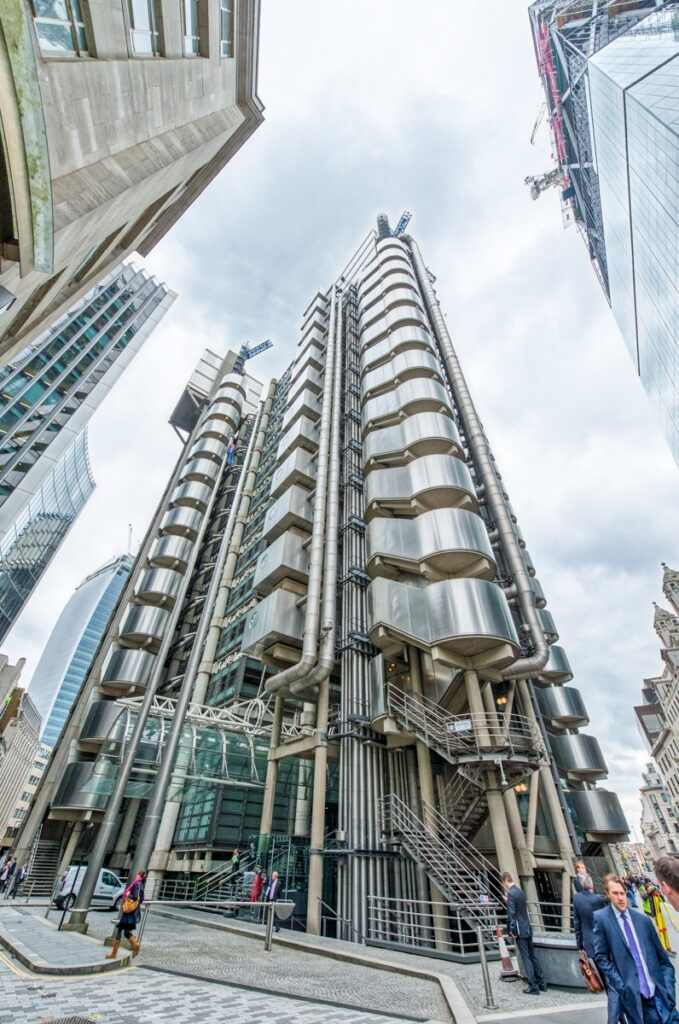 The Lloyd's building was designed by the architect Richard Rogers and took eight years to build. Access to the upper glassed-in floors is by exterior elevator.