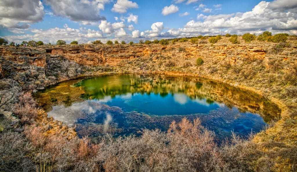 Montezuma Well is a detached unit of Montezuma Castle National Monumewnt near Campe Verde, Arizona. Sinaguan ruins nestle in the cliffs surrounding this limestone sinkhole, as well as along the edges.