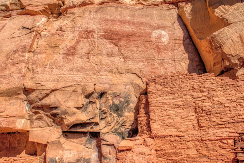 Closeup of ancient Sinaguan pictographs and ruins at Honanki Heritage Site, near Sedona, Arizona. Is that a moon figure above the wall?