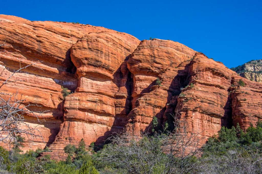 A closeup of the red sandstone cliffs that surround Palatki Heritage Site near Sedona, Arizona.