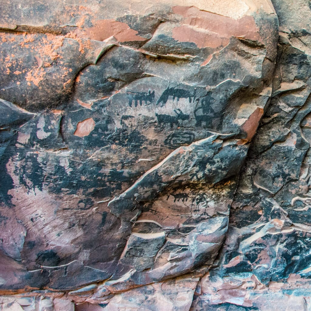 Closeup of a grouping of pictographs on a soot-covered cave wallat Palatki Heritage Site near Sedona, Arizona.