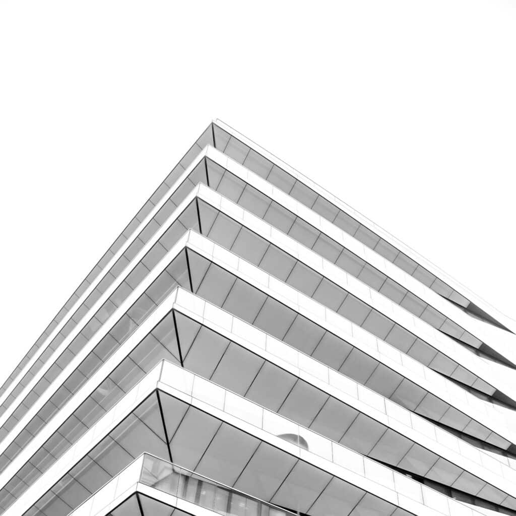 This is a view looking up at a modern building at the intersection of Arthur and Upper Thames Street in London, England.