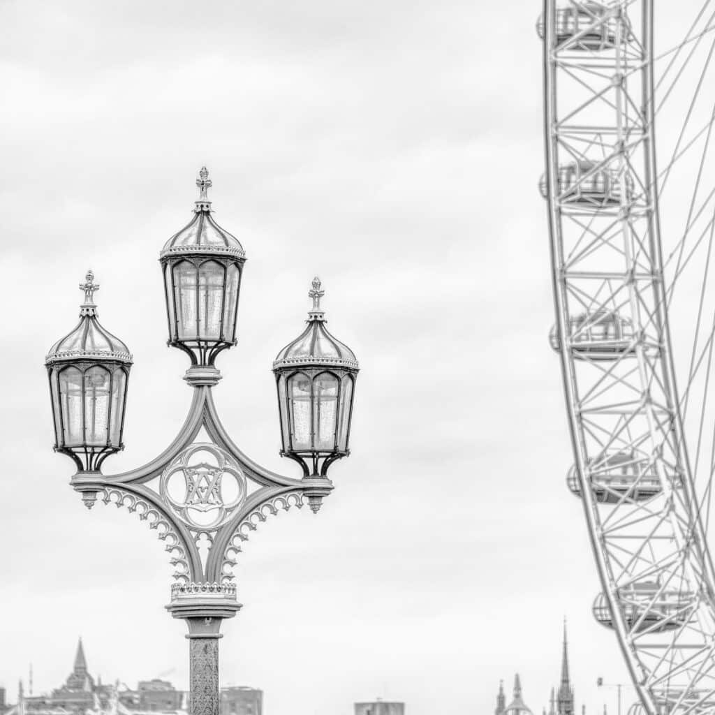 The Victorian style of this street light on the Westminster Bridge contrasts with the aggressively modern London Eye observation wheel.