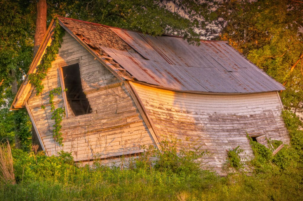 This old out-building is slowing losing its fight with gravity.