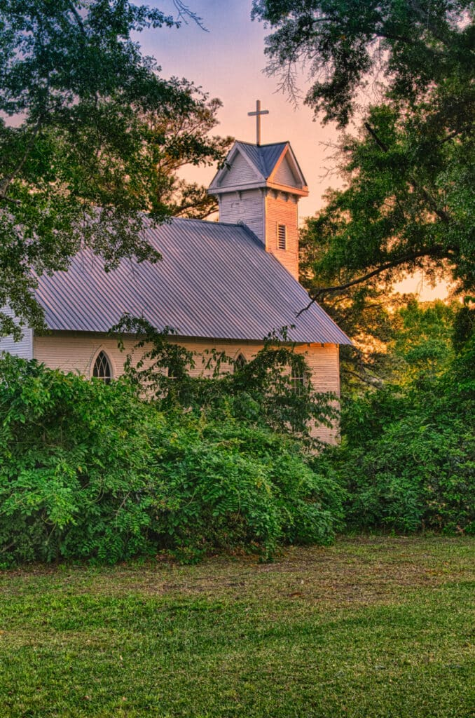 The sun sets on this 1881 clapboard church in Evergreen, Alabama