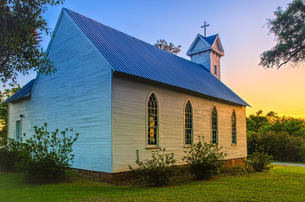 The sun sets on this 1881 clapboard church, the former St. Mary's Episcopal Church, in Evergreen, Alabama.