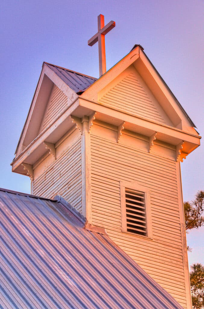Sunset light illuminates the steeple of Saint Mary's Episcopal Church in Evergreen, Alabama.