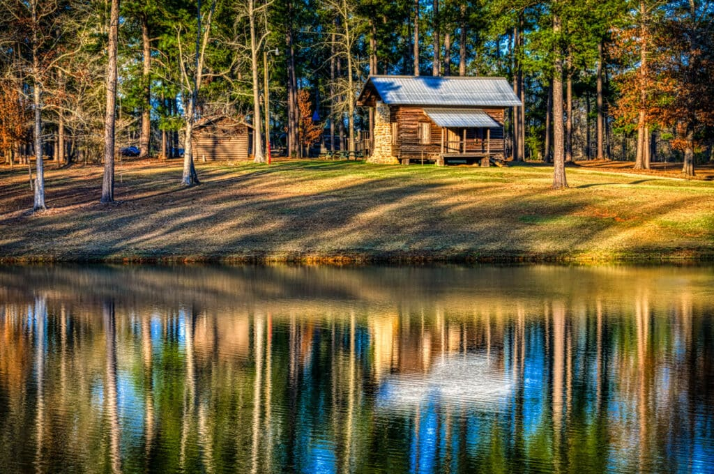 This restored cabin sits near the lake in Evergreen Municipal Park in Evergreen, Alabama. It is a section of a larger cabin built ca. 1877 by John Daniel Weaver, Jr. This section of the cabin originally served as the dining room.