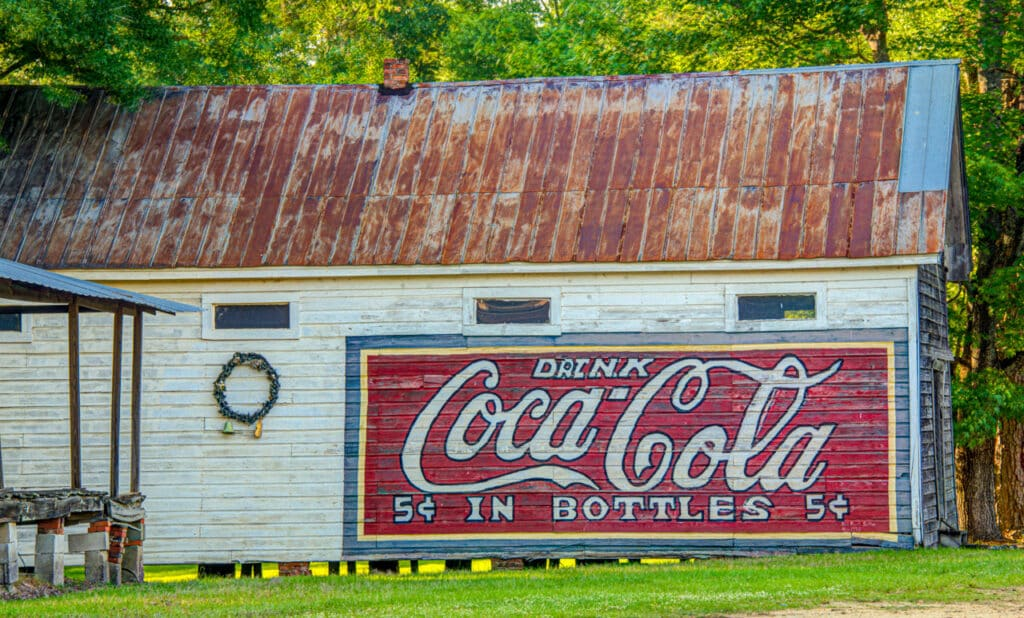 A Coca Cola sign adorns an old barn in Burnt Corn, Alabama, near Evergreen in Conecuh County.