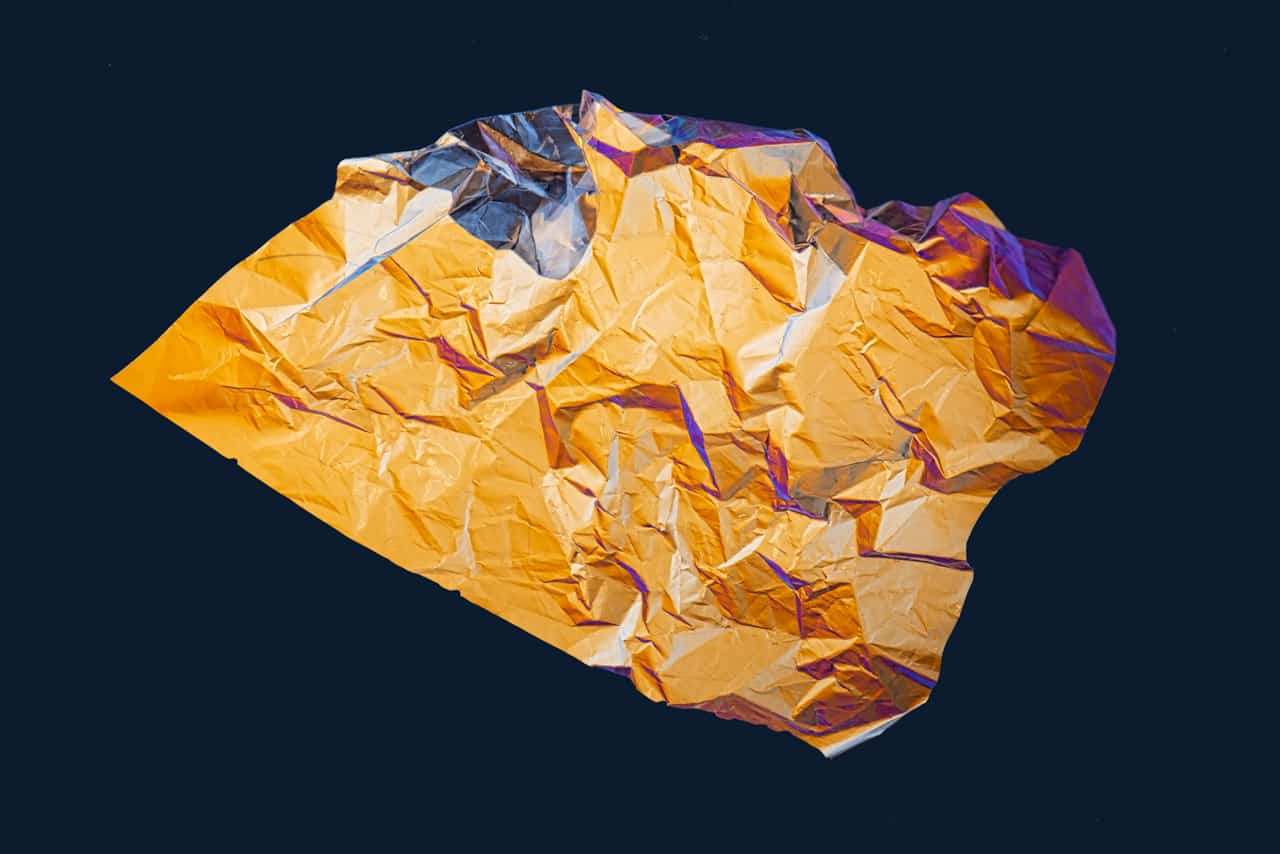 A crumpled sheet of plastic packaging is photographed using polarizing filters.