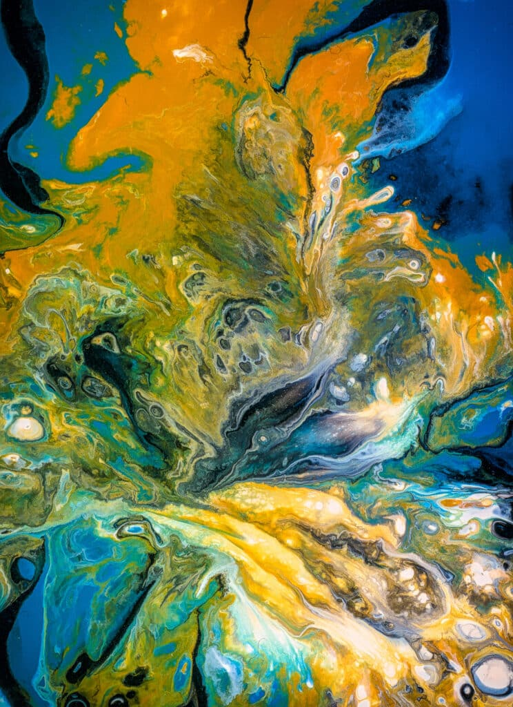 This is a photograph of different colored paint swirling in abstract compositions.