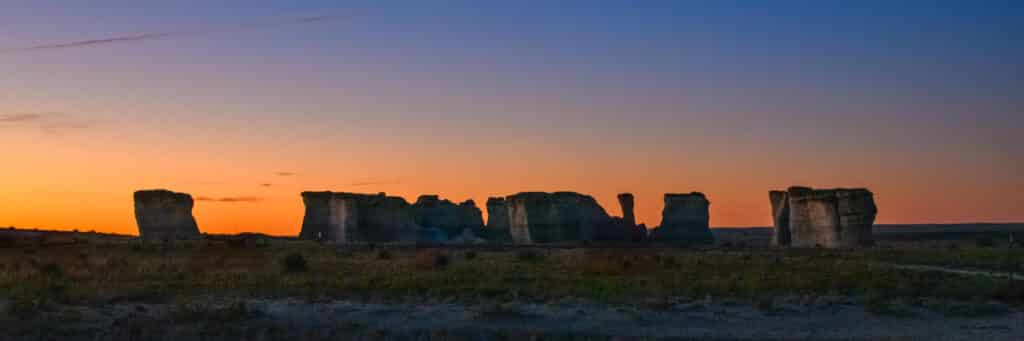 A panorama of a grouping of formations at Monument Rock at dawn near Oakley, KS.