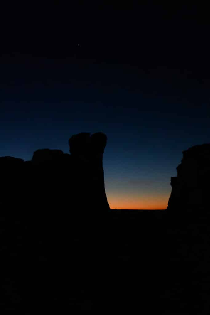 A view of first light between two formation at Monument Rocks, near Oakley, KS.