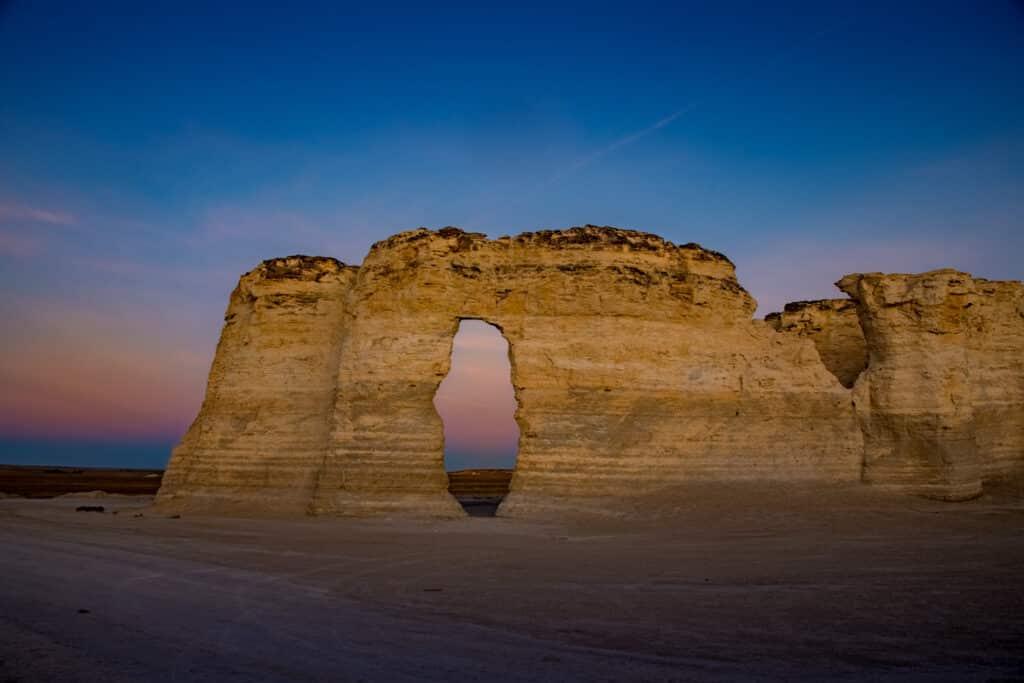 Soft morning light illuminates the front of a formation at Monument Rocks near Oakley, KS.