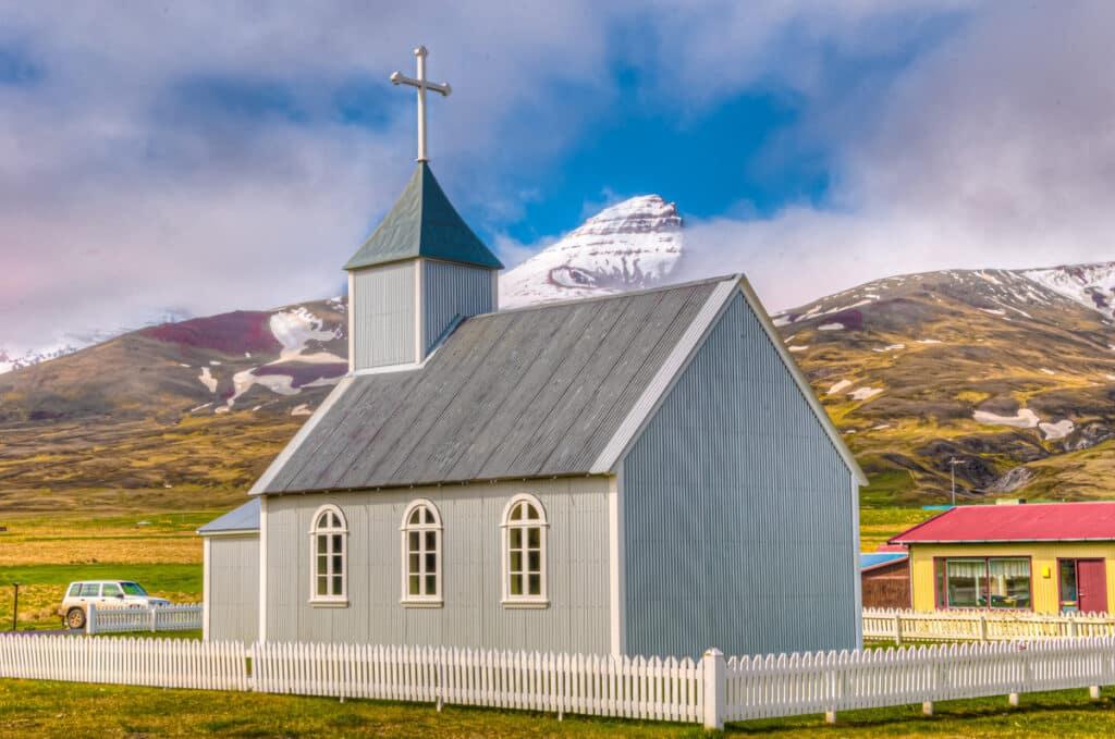 Peak of the mountain Dyrfjoll and the church Bakkagerðiskirkja in eastern Iceland.