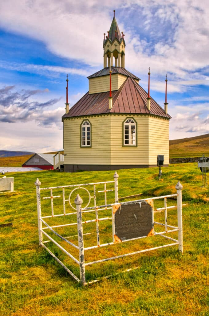Three graves in the cemetery at Auðkúlukirkja are beadsteads. The church itself is octagonal. Iceland seems to treasure creativity and individualism. Although we had never seen the practice before, it is apparently not that rare. For instance, iron bedframes are used in the Wind River Reservation cemetery in Fort Washakie, Wyoming, USA.