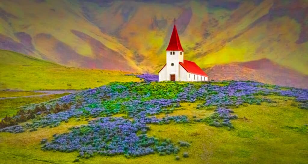 On a rainly afternoon, the church at Vik, sitting above the town in a field of lupine with a background of volcanic hills, catches a little afternoon sunlight.
