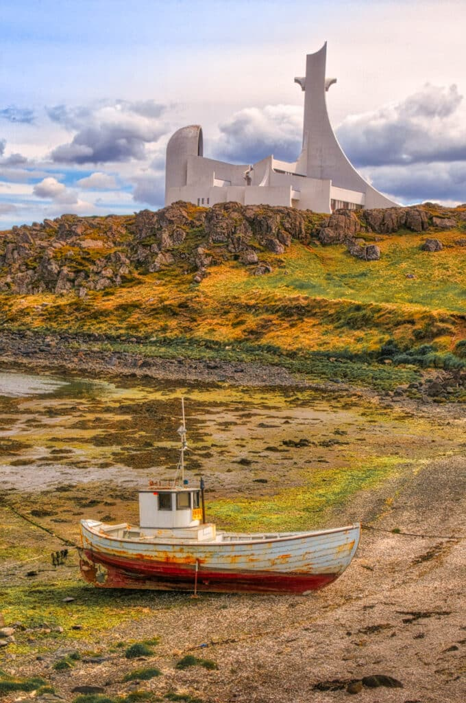 The modern church at Stykkishólmur, Iceland, looms over a simple boat.