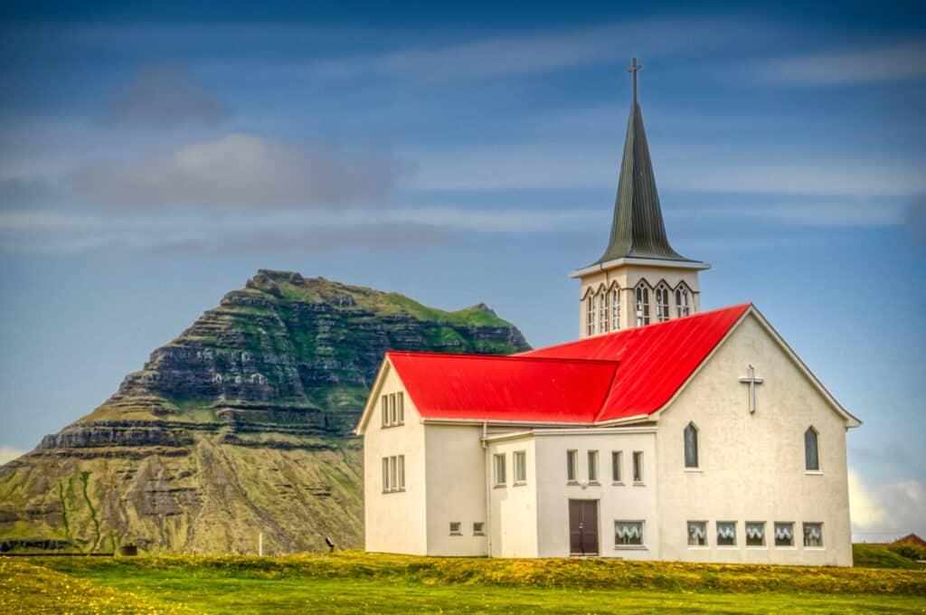 The church at Grundarfjörður, Iceland. The mountain in the background is Kirkjufell, which translates as Church Mountain.