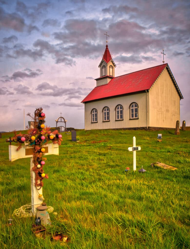 To an outsider, the electric lights on this cross at the church Hraungerðiskirkja in southeastern Iceland might seem odd. However, in a land where daylight is scarce for much of the year, the illuminated cross makes a fitting memorial - and a practical navigation aid to find the grave.