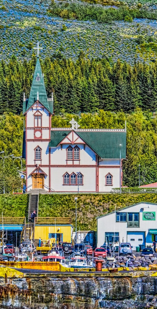 The church in the port town of Húsavík is a major landmark, with the belltower measuring 26 meters (over 85 feet) in height. It was built in 1907 from wood, a somewhat costly building material because it had to be imported from Norway.