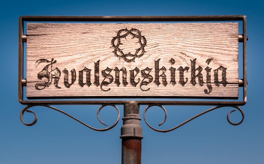 Sign for the stone church in Hvalsnes, overlooking the Atlantic, just west of the Keflavik Airport in Iceland.