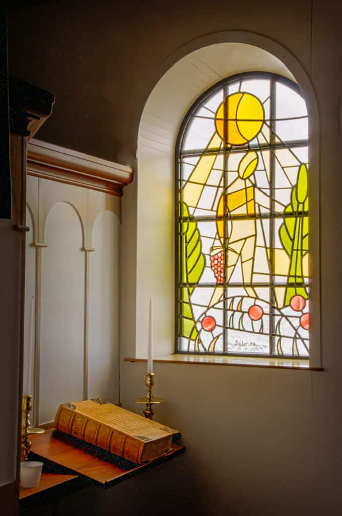 This is one of the stained glass windows seen from within the interior of the church in Vik on the south coast of Iceland. The window was designed and crafted by Hrafnhildur Agustsdottir.