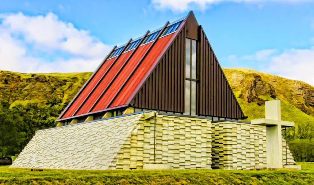 This modern church in Kirkjubaejarklaustur (referred to locally as Klauster) was built in 1974, a short distance from the foundations of one of the oldest religious buildings in Iceland, a Benedictine convent founded in 1186. The texture of the materials along with the A-frame design create a pleasing composition.