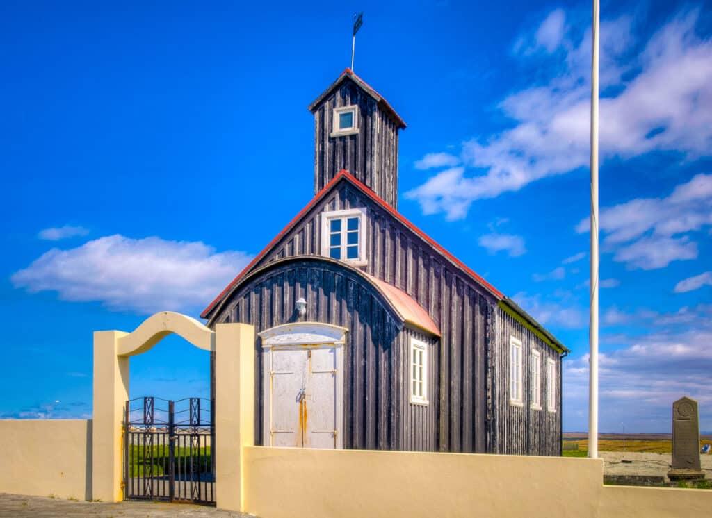 Kirkjuvogskirkja adorns the small village of Hafnir, along the western edge of the Reykjanes Peninsula, in an area called Kirkjuvogur.