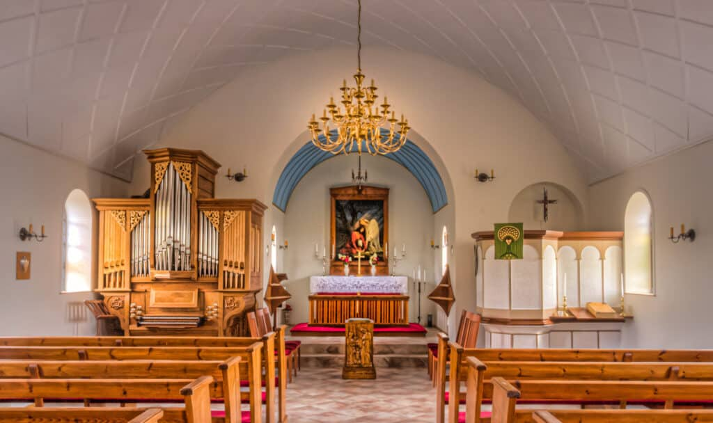 The interior of the Vik Church, also known as Reynir's Church, has a barrel vault ceiling. Notice the lovely pipe organ.