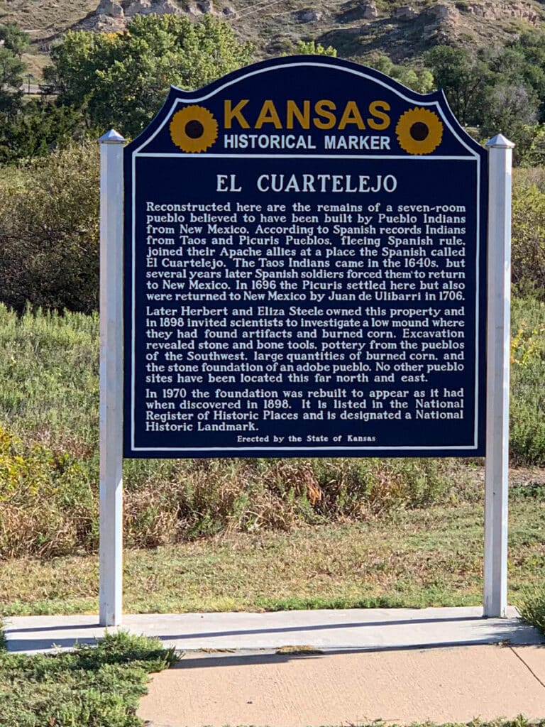 This historic marker provides a brief history of El Cuartelejo pueblos, which was built by refugees of the Taos Pueblo in New Mexico. It is located in Lake Scott State Park, Kansas.