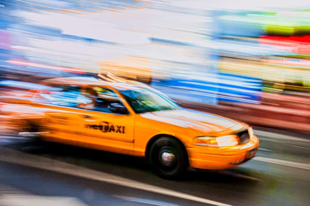 The required speeding taxi shot in New York City.