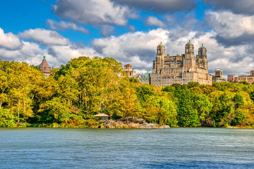 The Beresford looms large from this vantage point across The Pond in Central Park, New York.