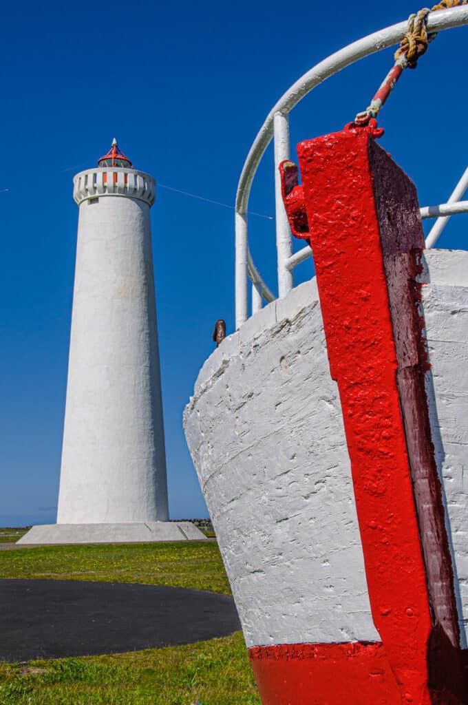 Lighthouse and boat at Garðskagi on the tip of Reykjanes, the peninsula at the southwest corner of Iceland.