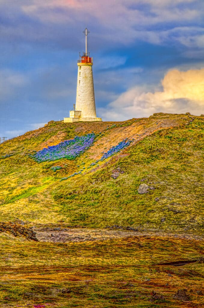 Lighthouse near the Gunnuhver geothermal field at the southwestern corner of Iceland. Luoine are growing down the hillside in the foreground.