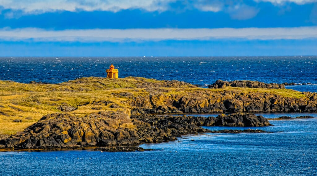 A view of Æðarstein Lighthouse from the road across the fjord near the town of Djúpivogur.